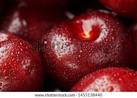 Ripe and fresh berries of a sweet cherry with water drops closeup. Cherry in the shape of a heart. Macro #1455138440