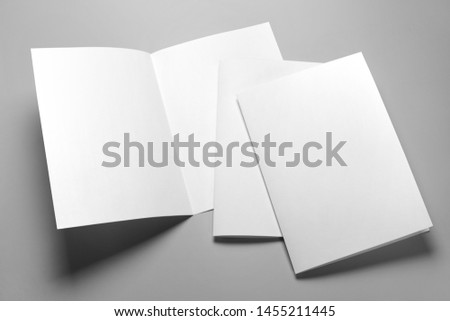 Blank half-folded booklet, postcard, flyer or brochure mockup template on gray background #1455211445