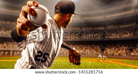Baseball player in action on a professional stadium Royalty-Free Stock Photo #1455281756