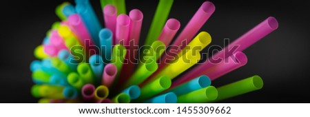 Colorful straws in front of black background #1455309662