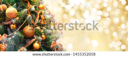 Christmas tree decorated with Golden balls toys on a blurred, sparkling and fabulous fairy background with beautiful bokeh, copy space. #1455352058