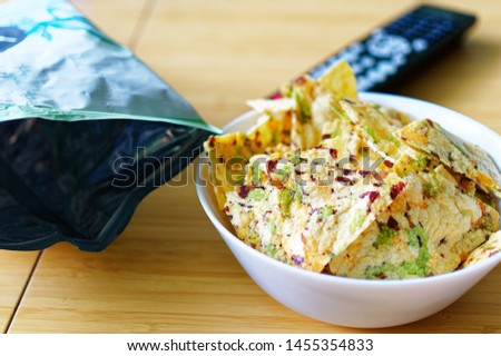 Chips made from natural ingredients on a bamboo table to illustrate snacks #1455354833