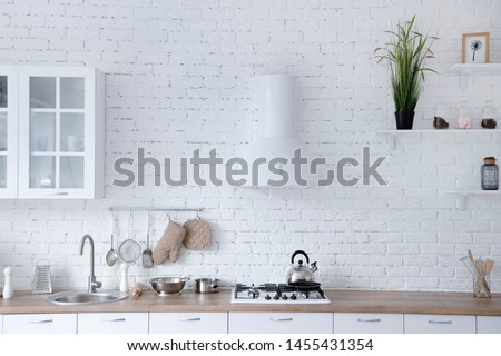 Interior of minimalistic kitchen with white walls, white floor, white countertops. Kitchen with white furniture. #1455431354