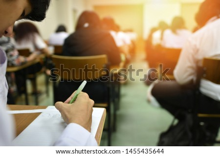 Students taking admission test in exam room at high school, college, or university, education or academic concept picture of professional or vocational learners in training session, selective focus Royalty-Free Stock Photo #1455435644