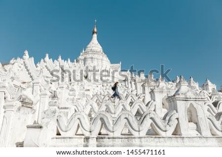 Mingun Mandalay Hsinbyume Pagoda Mandalay Myanmar, young woman on vacation in Myanmar walking above an temple Pagoda,white temple. Travelling in Myanmar #1455471161