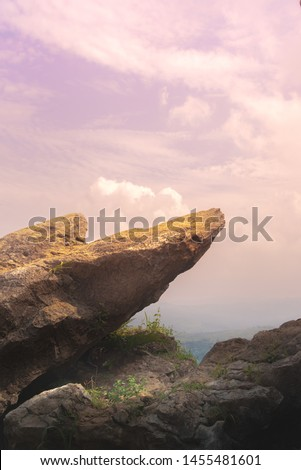Point Edge of Cliff King Rock on Stone Garden at The Very Top of Mountain During Pink Sunrise or Sunset #1455481601