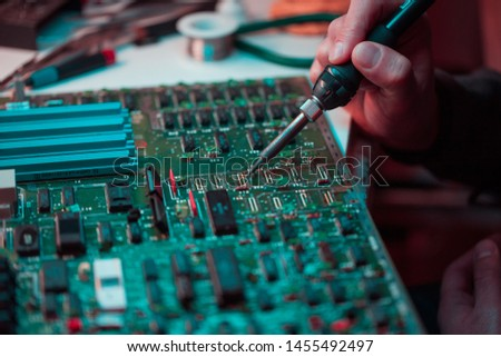 Circuit board futuristic server code processing. Computer repair. neon blue light. Orange, green, blue technology background with bokeh. Printed circuit board futuristic server      #1455492497