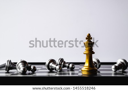A chess king last stand as a true winner.Money game concept. Copy space. #1455518246