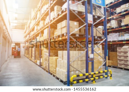Blur Warehouse inventory product stock for logistic background, Long shelves with a variety of boxes (Lights background) #1455536162