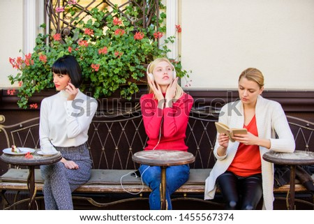 Different interests. Group pretty women cafe terrace entertain themselves with reading speaking and listening. Information source. Female leisure. Weekend relax and leisure. Hobby and leisure. #1455567374
