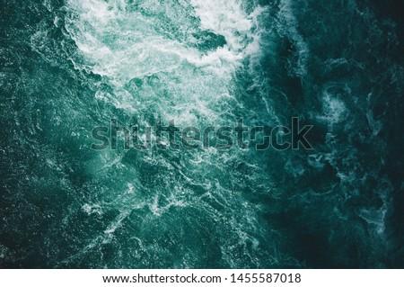 An overhead shot of beautiful textures of water in the ocean #1455587018