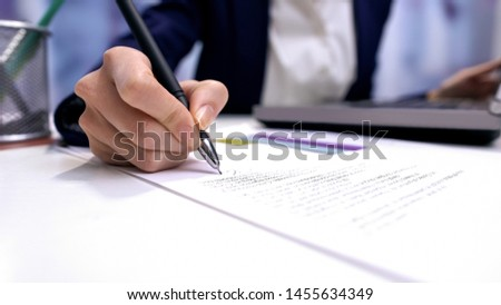 Female director signing document on office table, company agreement, business #1455634349