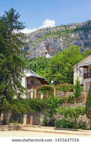 Montenegro. View of  Lower Ostrog Monastery, view of Upper Ostrog Monastery on the mountainside #1455637556