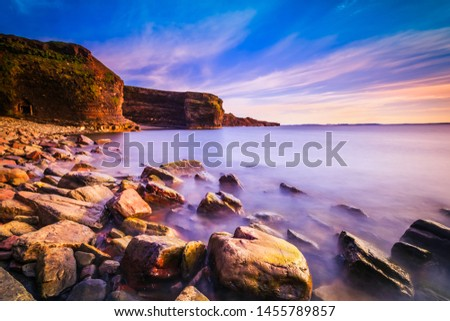 View of a beach at Bell Island, Newfoundland, Canada during sunset #1455789857