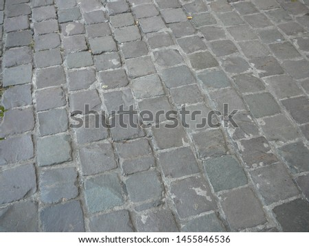 Decorative grey cobblestone textued background or backdrop #1455846536