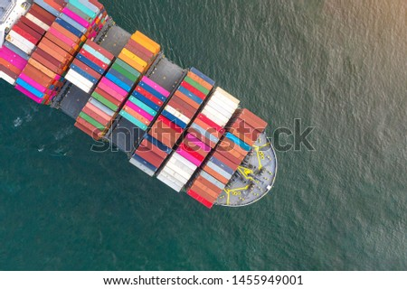 top aerial view of bulk head of containers ship sailing in the sea, carriage the shipment from loading port to destination discharging port, transport and logistics services to worldwide  #1455949001