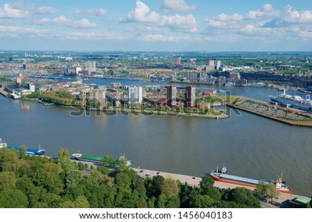 Rotterdam, Netherlands - June 02, 2013: Aerial view to the city and port of Rotterdam, Netherlands. #1456040183