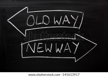 Old Way, New Way written on a blackboard with arrows pointing in the direction of the past and the future. A concept for adapting to change, improvement and development for the self or the business Royalty-Free Stock Photo #145613917
