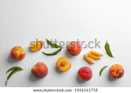 Composition with fresh peaches on white background, top view #1456161758