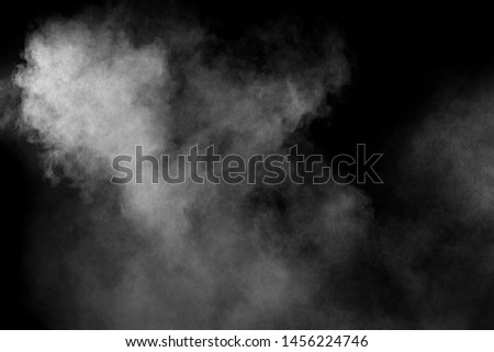 Abstract white powder explosion on a black background.Freeze motion of  white powder splash. #1456224746