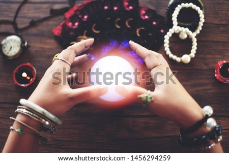 Psychic readings and clairvoyance concept / Crystal ball fortune teller hands and Tarot cards reading divination , Magic Spiritual and Horoscopes Occult #1456294259