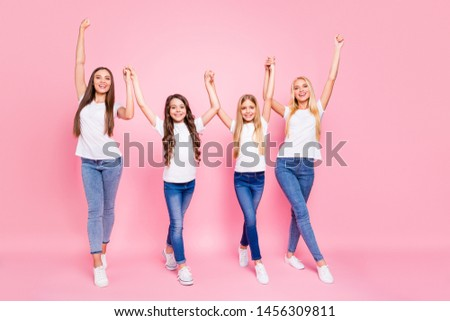 Two small and students ladies raising arms up ready for vacation wear casual outfit isolated pink background #1456309811