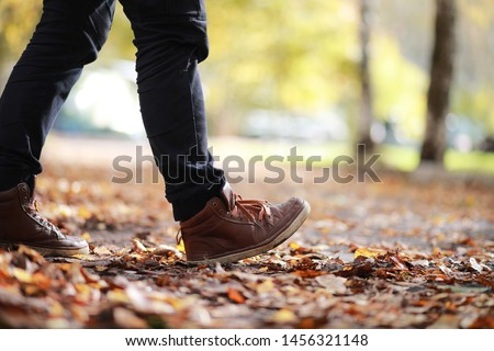 Autumn Park man walking along a path foliage #1456321148