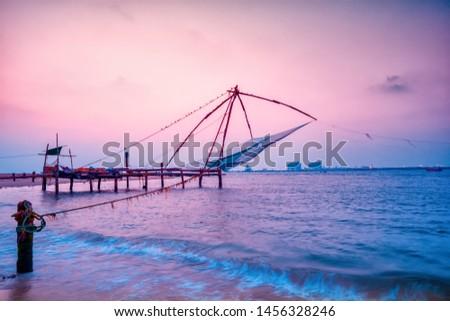 beautiful night scene of Kochi chinese fishnets in twilight Kochi, Kerala. Fort Kochin, Kochi, Kerala, south India, neon colors
