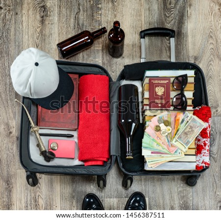 Suitcase with things. Suitcase with things to travel. Male rest #1456387511