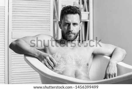 Man muscular torso sit in bathtub. Skin care. Hygienic procedure concept. Total relaxation. Personal hygiene. Take care hygiene. Nervous system benefit bathing. Cleaning parts body. Hygiene concept. #1456399499