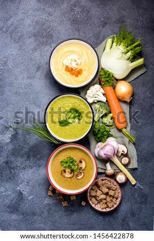 Different vegan soups with vegetables, clean eating, dieting and healthy food concept. Fennel and cauliflower soup, mushroom soup and broccoli soup #1456422878
