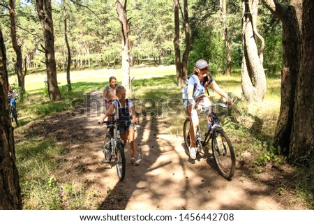 Voronezh, Russia, June 2019: Children cyclists, cycling through the forest, along a path with bumps.  Fun fun. #1456442708