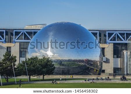 """PARIS, FRANCE - JANUARY 13, 2018: Mirror-ball building """"Geode"""" in Parc de la Villette - IMAX Theater. #1456458302"""