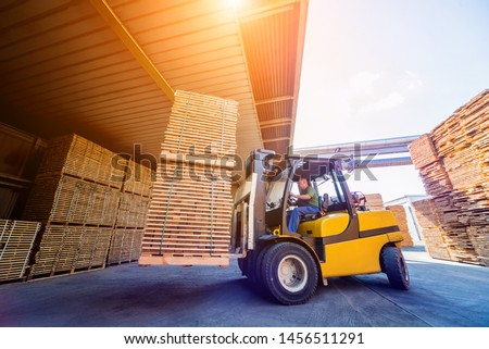 Forklift loader load lumber into a dry kiln. Wood drying in containers. Industrial concept #1456511291