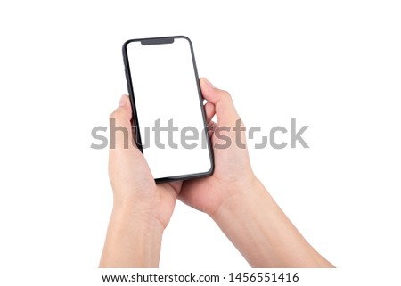 Female hand holding black cellphone with white screen at isolated background. #1456551416