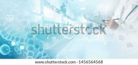 Medicine doctor write electronic medical record on tablet. DNA. Digital healthcare and network connection on hologram modern virtual screen interface, medical insurance, technology and network. Royalty-Free Stock Photo #1456564568