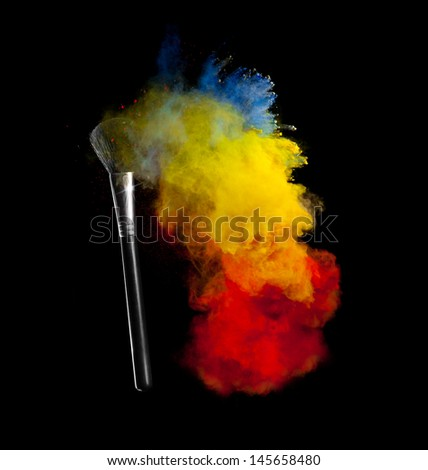 Freeze motion of colored dust explosion with brush, isolated on black background #145658480