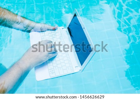 Male hands with a laptop working underwater. The concept of obstruction in the work. Blur Abstract Background #1456626629
