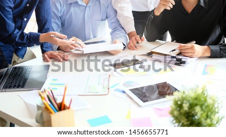 Strategy startup business with young businessman meeting on desk, Cropped shot photo. #1456655771
