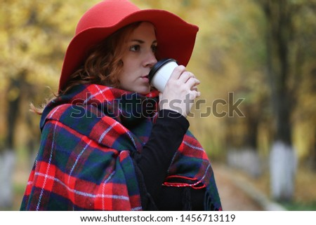 Young beautiful mother with her daughter on nature. A girl in a hat walks in park. Girl in autumn city park in leaf fall. #1456713119