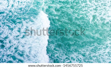 Aerial view beautiful of sea waves from drone. Top view of beautiful white sand beach with turquoise sea water. Tropical beach with sea and palm taken from drone.  #1456755725