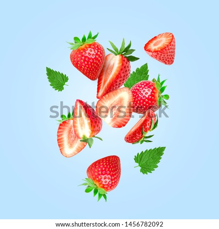 The composition of strawberries on a colored background. Cut strawberries into pieces with copy space. Fresh natural strawberry isolated #1456782092
