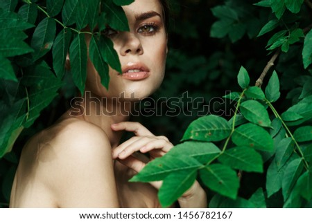 beautiful woman with makeup with green tropics leaves #1456782167