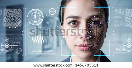 Authentication by facial recognition concept. Biometric. Security system. Royalty-Free Stock Photo #1456783511