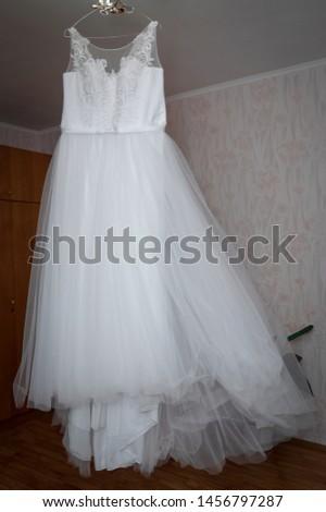 Bride's dress. White dress. Grooming dress White dress in the center of the room. #1456797287