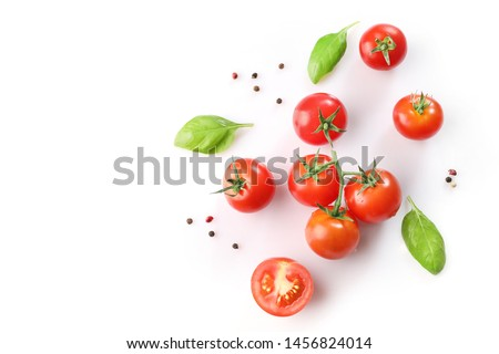 Ripe red cherry tomatos  and basil on white background. Top view #1456824014