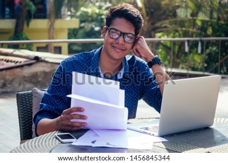 Indian Asian college student studying freelancer working with a laptop on the beach summer cafe .freelance and remote work.businessman at veranda balcony #1456845344