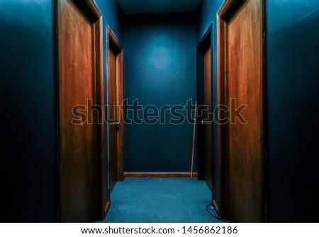 Empty Blue Hallway with wood doors and a hint of creepy #1456862186