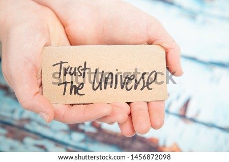 Trust the universe, law of attraction concept  Royalty-Free Stock Photo #1456872098