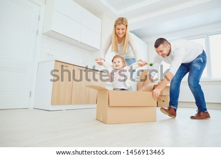 Happy family unpacking boxes at new home #1456913465